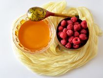 Framboise avec du miel Photo stock