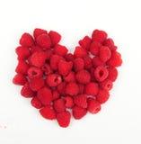 Framboises dans une forme de coeur Photo stock