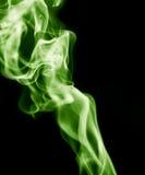frambragte den svarta burning oklarheten för abstrakt bakgrund utmärkt grön rökelse som looksrökgift Arkivbilder