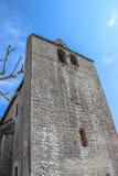 Framdel av den stärkte kyrkan av Saint Julien, Nespouls, Correze, Limousin, Frankrike Arkivfoto
