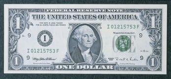 Framdel av en en dollar bill Royaltyfri Foto