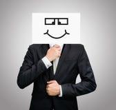Framdel för innehav för framsida för leende för stående vitbok för affärsman lycklig Fotografering för Bildbyråer