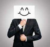 Framdel för innehav för framsida för leende för stående vitbok för affärsman lycklig Royaltyfria Foton