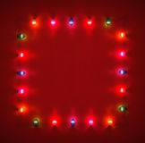 Frame  ​​from glowing light bulbs. Frame for Christmas cards made ​​from glowing lights garland Stock Images