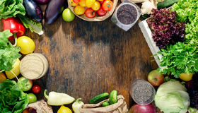 Frame of abundance of healthy food on wooden table royalty free stock images