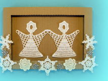 Frame and angels. Paper cutting stock image
