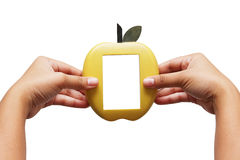 Frame apple in hand. Apple, maker of wood Royalty Free Stock Photos