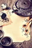 Frame with asian teapot, cups and infuser Stock Image