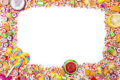 Frame of assorted candies and lollipops Royalty Free Stock Photos