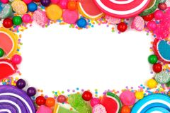 Frame of assorted colorful candies over white Royalty Free Stock Photo