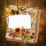Frame with autumn leaves and berries on wooden background Royalty Free Stock Photo