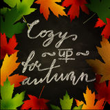 Frame of autumn leaves painted on black chalkboard Stock Image