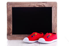 Frame and baby shoes Royalty Free Stock Images