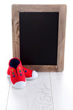 Frame and baby shoes Stock Photo
