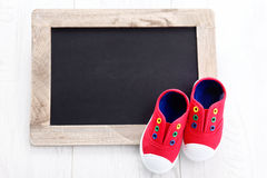 Frame and baby shoes Royalty Free Stock Image