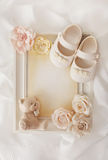 Frame background and baby shoes Royalty Free Stock Image