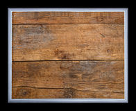 Frame on a background of old wood. Isolated on black background royalty free stock images