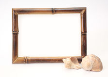 Frame from a bamboo and two shells Stock Photography