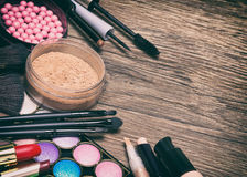 Frame of basic makeup products with copy space. Frame of basic make-up products with copy space, toned image. Make up essentials checklist. Makeup bag must-haves Royalty Free Stock Photos