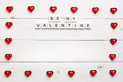 Frame and Be my valentine on wooden background Royalty Free Stock Image