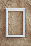 Frame on beige wrinkled paper Royalty Free Stock Images