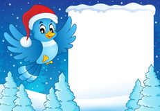 Frame with bird in Christmas hat Royalty Free Stock Photography