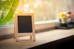 A-frame black board on wood bar Royalty Free Stock Image