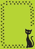 Frame with black cat and cat paw on green backgrou Stock Images