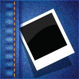 Frame on a blue jeans background Stock Photos