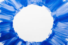 Frame of blue paints on white background. White circle on azure smears of nail polish, free space. Sky, sea, winter, cosmetic, abstract art, beauty concept Royalty Free Stock Photo