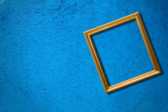 The frame on the blue wall. Stock Photos