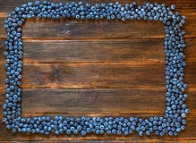 Frame of  blueberry on dark wooden background. Stock Photos