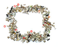 Frame of bolts and screws on white Royalty Free Stock Images