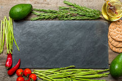 Frame or border of assorted fresh vegetables Stock Photography