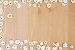 Frame border made of old buttons on wooden background. Frame border made of old vintage buttons on wooden table. Copy space for text royalty free stock photos