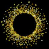 Frame or border of random scatter snowflakes. Round gold frame or border of random scatter golden snowflakes on black background. Design element for festive Stock Photos