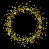 Frame or border of random scatter snowflakes. Round gold frame or border of random scatter golden snowflakes on black background. Design element for festive Royalty Free Stock Images