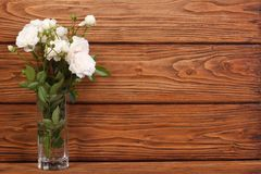 Frame of the bouquet of white roses on a wooden Royalty Free Stock Image