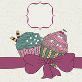 Frame with a bow and muffins Royalty Free Stock Photography
