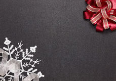 Frame with bow, ribbon and snowflake Royalty Free Stock Image