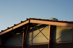 Frame bracing on warehouse roof and wall during sun set.. Frame bracing on warehouse roof and wall during sun set Royalty Free Stock Photos