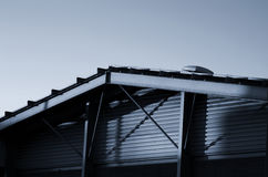Frame bracing on warehouse roof and wall during sun set.. Frame bracing on warehouse roof and wall during sun set Royalty Free Stock Images