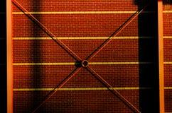 Frame bracing on warehouse wall during sun set. Frame bracing on warehouse wall during sun set Royalty Free Stock Image
