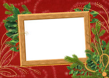 Frame with branches on the claret background. Wooden frame with spruce branches on the claret background Stock Image