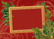 Frame with branches on the claret background. Wooden frame with spruce branches on the claret background Stock Images