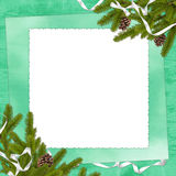 Frame with branches on the green background. White frame with branches and ribbon on the green background Stock Photography