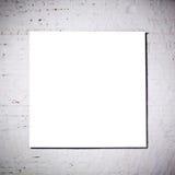 Frame branco na parede de tijolo branca Foto de Stock