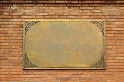 Frame Brass on brickwall Royalty Free Stock Photos