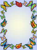 Frame of bright butterflies on a gentle blue background,. Rectangle Royalty Free Stock Image