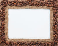 Frame of burlap and coffee beans. Lying on a white background Stock Photos